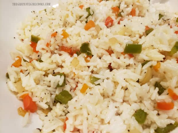 Rainbow rice is mixed together and then seasoned with salt, pepper, and garlic powder.