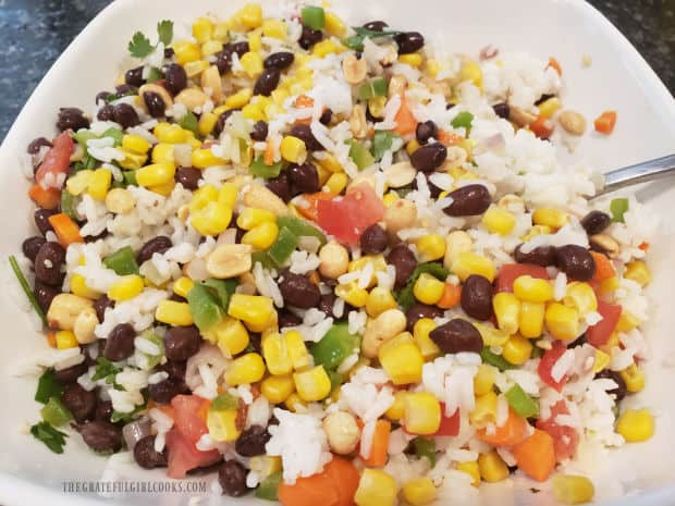 Southwestern Rice Salad is very colorful after adding all the ingredients.