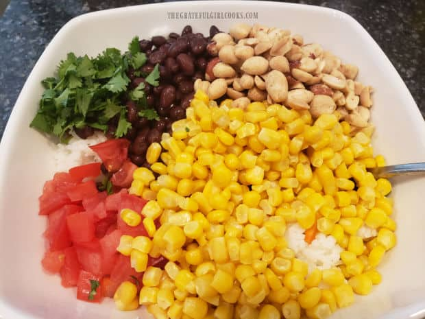 Corn, black beans, tomatoes, cilantro and salted peanuts are added to the Southwestern rice salad.