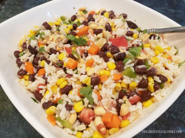 After chilling in the refrigerator, the Southwestern Rice Salad is served in a white bowl.