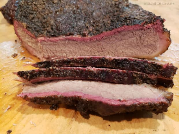 Slices of smoked brisket of beef on a cutting board, ready to enjoy.