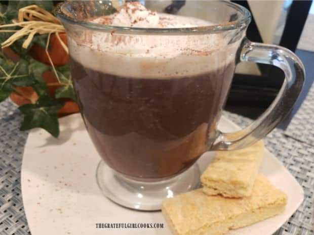 Hot mug of cinnamon mocha coffee, is served with shortbread cookies for a nice treat.