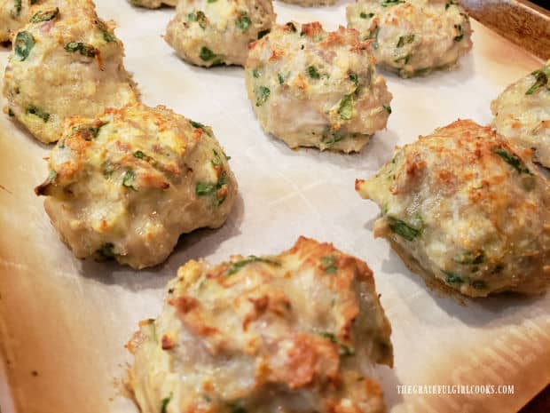 Once baked, the Italian Chicken Parmesan Meatballs will be golden brown on top.