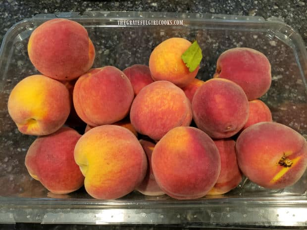 Fresh peaches are ready to peel, pit and slice for the cobbler skillets.