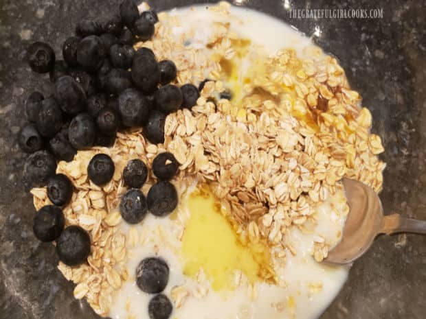 Blueberries, milk, melted butter, vanilla and eggs are added to the batter and stirred in.