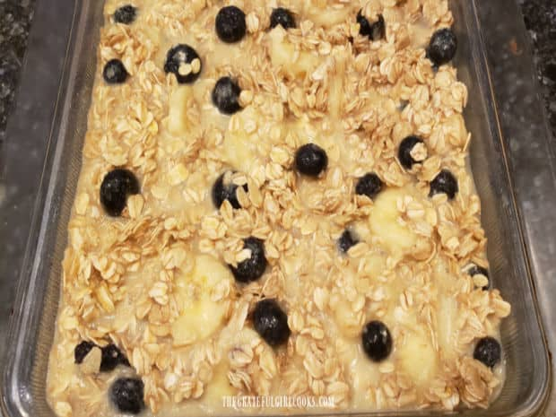 A baking dish full of the oatmeal mixture, ready to go into the oven.
