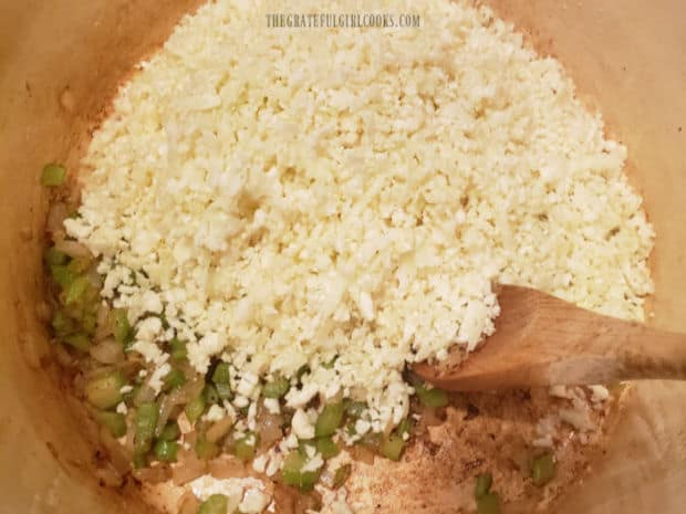 Water and grated cauliflower are added to the soup pot and steamed until tender.
