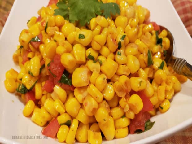 A close up look at the Southwestern skillet corn in a serving bowl.